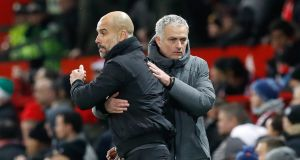 Manchester City manager Pep Guardiola  and Manchester United manager Jose Mourinho after the final whistle of the derby which City won 2-1. Photograph: PA Wire