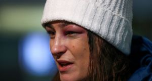Katie Taylor arrives home to Dublin Airport after successfully defending her lightweight title  against America's Jessica McCaskill. Photograph: James Crombie/Inpho