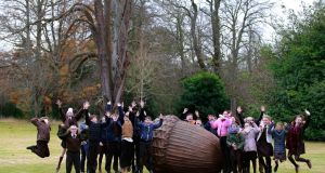 Sixth class pupils from Gaelscoil Eoghain Uí Thuairisc in Co Carlow with Rachel Joynt's sculpture Dearcán na nDaoine/The People's Acorn, which was unveiled at Áras an Uachtaráin. Photograph: Nick Bradshaw