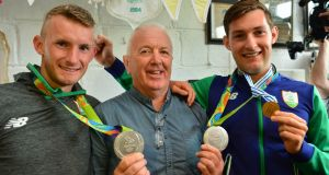 Olympic silver medalists Gary and Paul O'Donovan with coach Dominic Casey at Skibbereen Rowing Club. Photograph: Michael MacSweeney/Provision