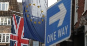 A Union flag, an EU Flag and a 'One Way' street sign in London: Leave voters are unlikely to blame a disappointing Brexit on their own decision last year. Photograph: Daniel Leal-Olivas/AFP/Getty Images