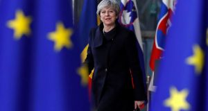 Britain's prime minister Theresa May arrives for an  EU summit in Brussels, where EU leaders are to agree formally that sufficient progress has been made to move to next phase of talks. Photograph: Yves Herman/Reuters