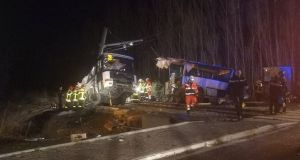 Rescue workers  on the site of collision between a train and a schoolbus in Millas, France, on Thursday night. Photograph: France Bleu Roussillon via Reuters