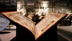 "An ancient book with Jewish text, part of the ""Welcome to Jerusalem"" exhibition in  Berlin.  The diverse challenges Jerusalem faces are presented in historical displays, artistic reactions and medial staging. Photograph: Felipe Trueba/EPA"