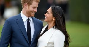 Britain's Prince Harry with Meghan Markle after announcing their engagement at Kensington Palace in London in November. Photograph: Facundo Arrizabalaga/EPA