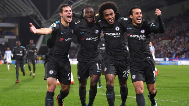 Cesar Azpilicueta, Victor Moses, Willian, and Pedro of Chelsea celebrate Pedro's goal against Huddersfield at John Smith's Stadium. Photograph: Laurence Griffiths/Getty Images