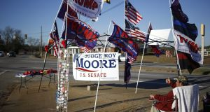 Flags in support of President Donald Trump for sale ahead of the failed campaign rally for Roy Moore, Republican candidate for Alabama. Photograph: Luke Sharrett/Bloomberg