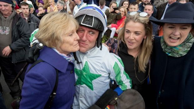 Jessica Harrington celebrates Our Duke's Grand National win with Power and her daughters Kate and Emma. Photograph: Morgan Treacy