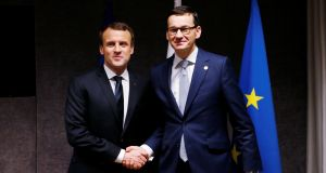 French president Emmanuel Macron and Poland's prime minister Mateusz Morawiecki ahead of a bilateral meeting at the European Union leaders summit in Brussels on Friday. Photograph: Francois Lenoir/Reuters