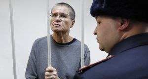 Former Russian economic development minister Alexei Ulyukayev in a defendant's cage after the verdict was announced at the Zamoskvoretsky District Court in Moscow on Friday. Photograph:  Yuri Kochetkov/EPA