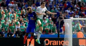 Seamus Coleman rises highest in the last-16 clash between Ireland and France at Euro 2016. Photograph: Inpho