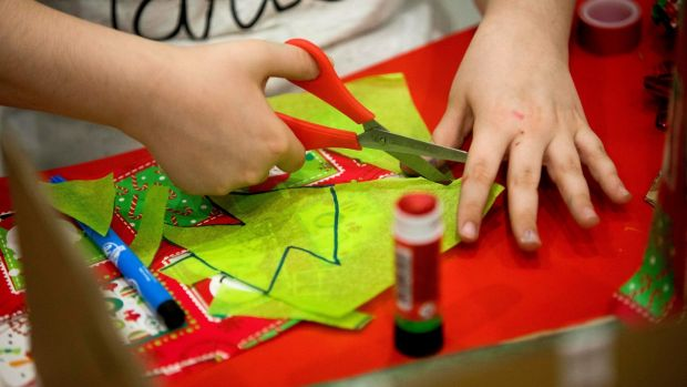 "A child at ""My Christmas World"", Focus Ireland's art workshop. Photograph: Tom Honan"