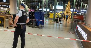 A view inside Schiphol airport after a man wielding a knife was shot by military police, in the Netherlands. Photograph: Evert Elzinga/EPA