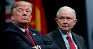 US president Donald Trump with attorney general Jeff Sessions during a graduation ceremony at the FBI's headquarters in  Quantico, Virginia, on Friday. Photograph: AP Photo/Evan Vucci