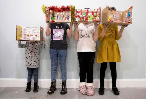 MY CHRISTMAS WORLD Children from the Bram Stoker Homeless Hub, in Clontarf in Dublin, show models they have made of where they will be spending Christmas, at a Focus Ireland art workshop. Photograph: Tom Honan