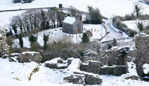 WINTER WEATHER Snow-covered hills around Holy Trinity church, at the main entrance to the Rock of Dunamase, in Co Laois. Photograph: Niall Carson/PA Wire