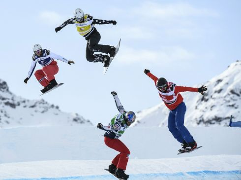 WINTER SPORTS Fabio Cordi of Italy, Regino Hernández of Spain, Nate Holland of the US and Alex Pullin of Australia compete in the snowboard cross world cup in Val Thorens, in the French Alps. Photograph: Philippe Desmazes/AFP/Getty
