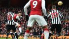 Arsenal's German midfielder Mesut Ozil scores against Newcastle at the Emirates Stadium. Photograph: Getty Images