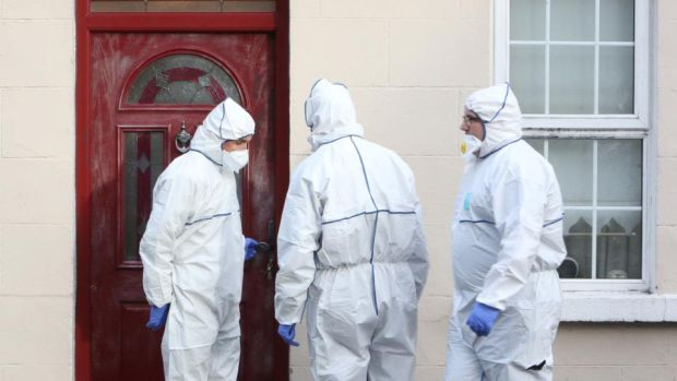 Forensic gardaí outside the home of the late Rose Hanrahan in Limerick. Photograph: Liam Burke/Press22