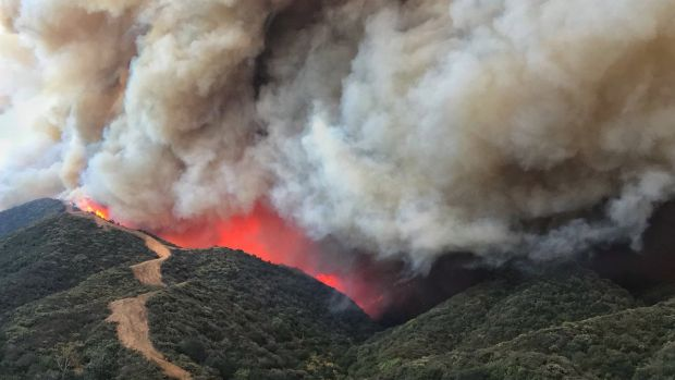 A handout photo made available by the Santa Barbara County Fire Department shows flames churn towards a large fire break near homes along Gibraltar Road north of Santa Barbara California. Photograph: EPA