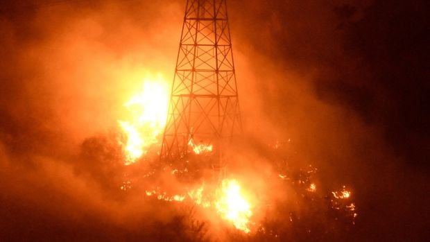 Fires burn around power line towers in Coyote Canyon near Montecito. Photograph: Reuters