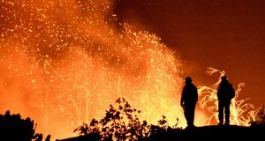 The Thomas wildfire burns in the hills and canyons outside Montecito. Photograph:  Reuters