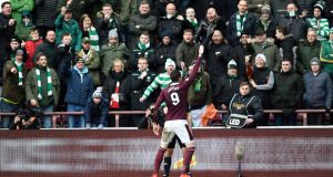 Hearts' Kyle Lafferty celebrates in front of the Celtic fans after scoring his side's second goal. Photo: Ian Rutherford/PA Wire