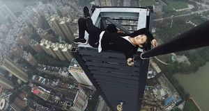 An image from a YouTube video of Wu Yongning, who amassed thousands of online followers with his high-altitude stunts, before dying in a fall last month. Photograph: via Weibo