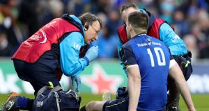 Johnny Sexton receives treatment after suffering an early head injury against Exeter at the Aviva Stadium.  Photograph: Dan Sheridan/Inpho