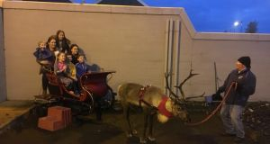 Children sit in Santa's sleigh at the Twaddell-Ardoyne Shankill Communities in Transition festive event on Saturday. Photograph: Amanda Ferguson