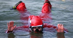THE SWIMMER: Ellen Hanley from Kilkenny enjoying the Santa Swim in Sandymount.  Photograph Nick Bradshaw