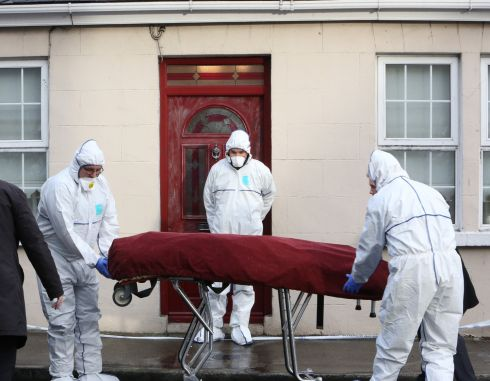 MURDER INQUIRY: The body of Rosie Hanrahan is removed from her home at 55 New Road, Thomondgate. Gardai are investigating. Photograph Liam Burke/Press 22