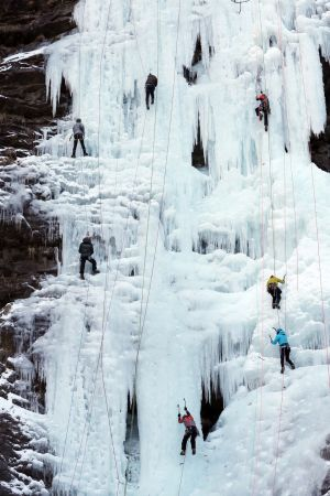 COLD CALM: Climbers scale an ice cliff at the Gugok Waterfall in Chuncheon, 85km east of Seoul, as South Korea is hit by a cold snap, with the mercury dropping to a low of -14.5 degrees in the region.  Photograph: Yonhap/EPA
