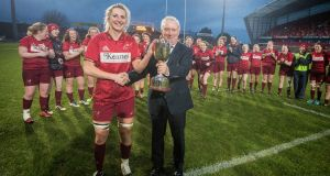 Munster's Siobhán Fleming receives the women's interprovincial trophy at Thomond Park. Photograph: Ryan Byrne/Inpho