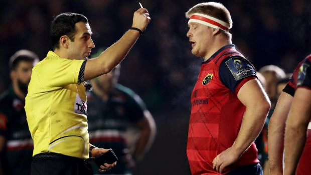 John Ryan receives a yellow card from referee Mathieu Raynal. Photo: Tommy Dickson /Inpho