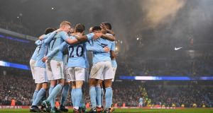Manchester City players celebrate after the fourth goal in their 4-1 Premier League win over Tottenham Hotspur. Photo: Laurence Griffiths/Getty Images