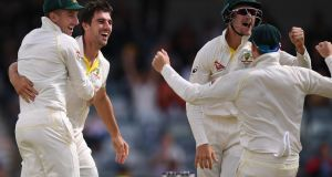 Australia celebrate Pat Cummins' wicket of England's Stuart Broad for duck on day five of the third Ashes Test at the WACA ground in Perth. Photograph: PA