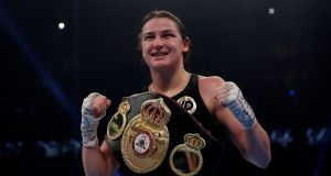 Katie Taylor celebrates with the belt at the end of the fight. Photograph: Andrew Couldridge/Reuters