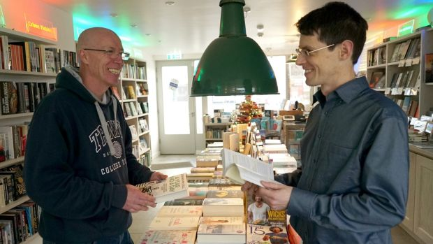 "Neil Paul (left) manager of Books@One, Louisburgh, Co Mayo: ""The community sense was the number one goal."" Photograph: Enda O'Dowd"