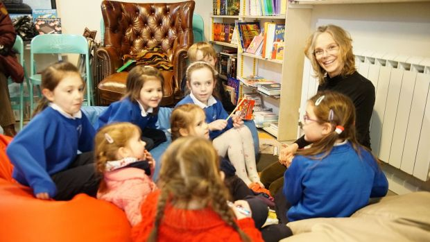 Shelley Upchurch at story time in Books@One: she moved to Mayo from Costa Rica after reading an online article in this newspaper that Westport had won The Irish Times Best Place to Live competition in 2012. Photograph: Enda O'Dowd