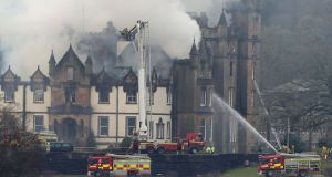 Firefighters at the scene of a fire at the Cameron House hotel on the banks of Loch Lomond in Scotland. Photograph: Andrew Milligan/PA Wire