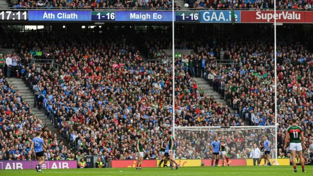 Dean Rock of Dublin kicks the winning point against Mayo. Photograph: Ray McManus/Sportsfile via Getty Images