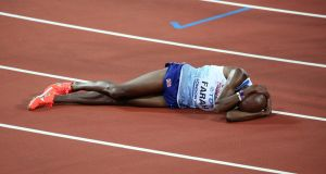 Mo Farah reacts after losing the 5,000m final at the World Athletics Championship. Photo: Getty Images