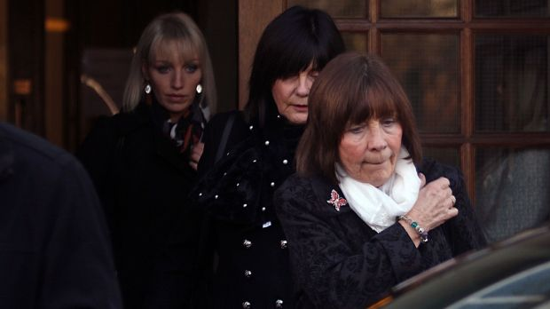 The visibly distressed mother of Clodagh Hawe, Mary Coll (front) Aunt Carmel (middle) and sister Jacqueline Connolly leave the inquest into the deaths of the Hawe family at Cavan Courthouse on Monday afternoon. Photo: Lorraine Teevan