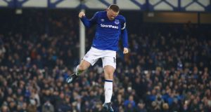 Wayne Rooney of Everton celebrates as he scores their third goal from the penalty spot during the Premier League win over Swansea City. Photo: Clive Brunskill/Getty Images