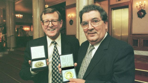 Nobel Peace Prize winners David Trimble and John Hume display the Alfred Nobel medals in Oslo City Hall in 1998. Photograph: Matt Kavanagh