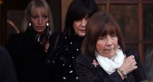 The mother of Clodagh Hawe, Mary Coll (front), aunt Carmel (middle) and sister Jacqueline Connolly leave the inquest into the deaths of the Hawe family at Cavan Courthouse on Monday afternoon. Photograph: Lorraine Teevan