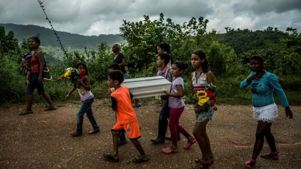 Children carry the coffin of three-month-old Kleiver Enrique Hernández, to the cemetery from his home in Urdaneta, Venezuela. Photograph: Meridith Kohut/The New York Times