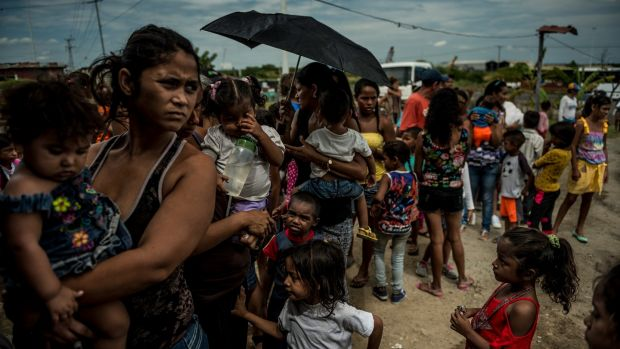 Families line up at a free children's health clinic in Morón, Venezuela. Photograph: Meridith Kohut/The New York Times