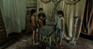 Children view the body of their 17-month old cousin, Kenyerber Aquino Merchán, who died of heart failure caused by severe malnutrition, in San Casimiro, Venezuela. Photograph: Meridith Kohut/The New York Times